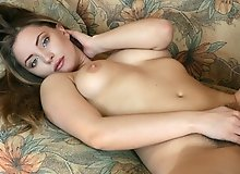 Tami tames her hairy pussy on the couch
